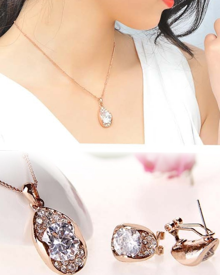 $7 for 18 Karat Gold Solitaire Tri-Cut Diamond Necklace and Earring Set OR $11 for 2